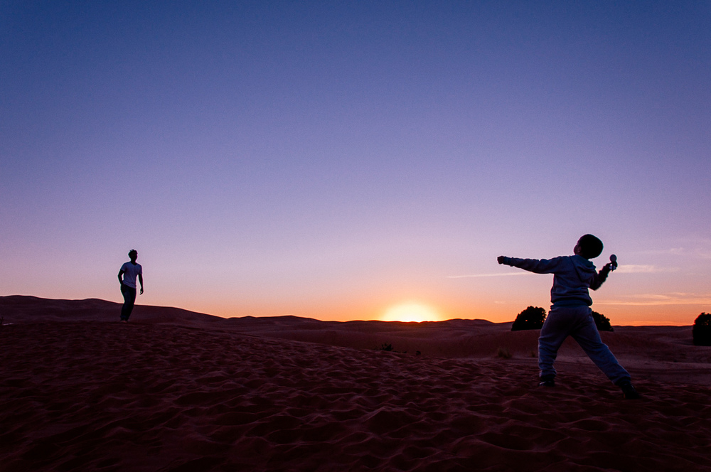 Before leaving the Sahara desert, we played catch with some of the local children.
