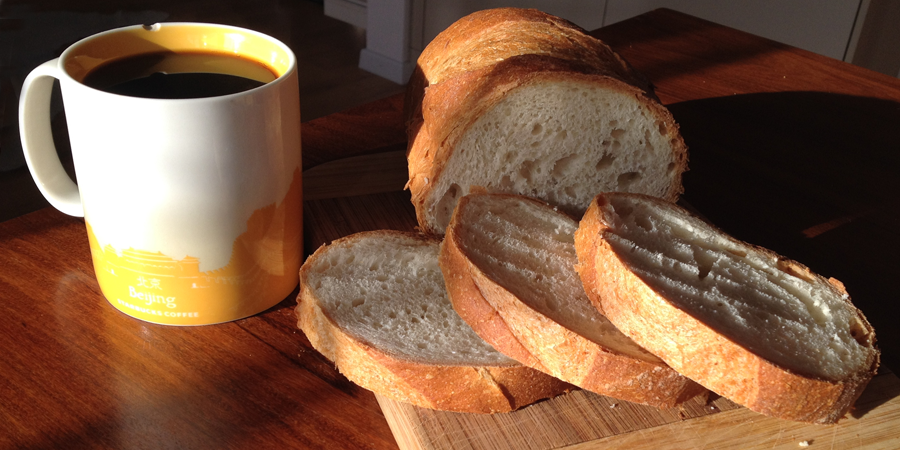 chipped coffee cup &  fresh bread (c) mark somple 2014