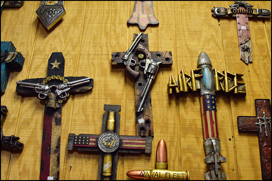 i thought jesus said to love not blast thine enemy?  actual crosses in a western store (c) mark somple 2018
