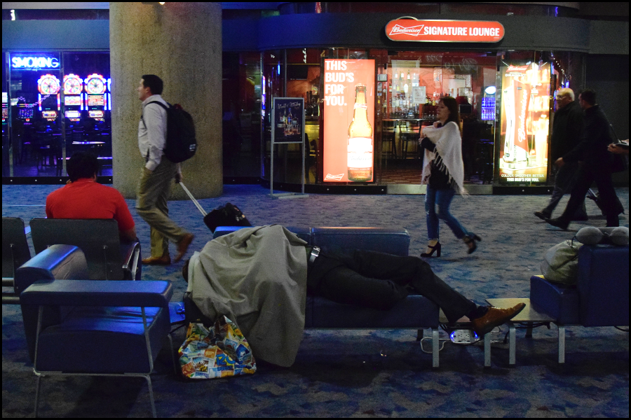 dude sleeping in the vegas airport. but that seems normal to all that walk by (c) mark somple 2018