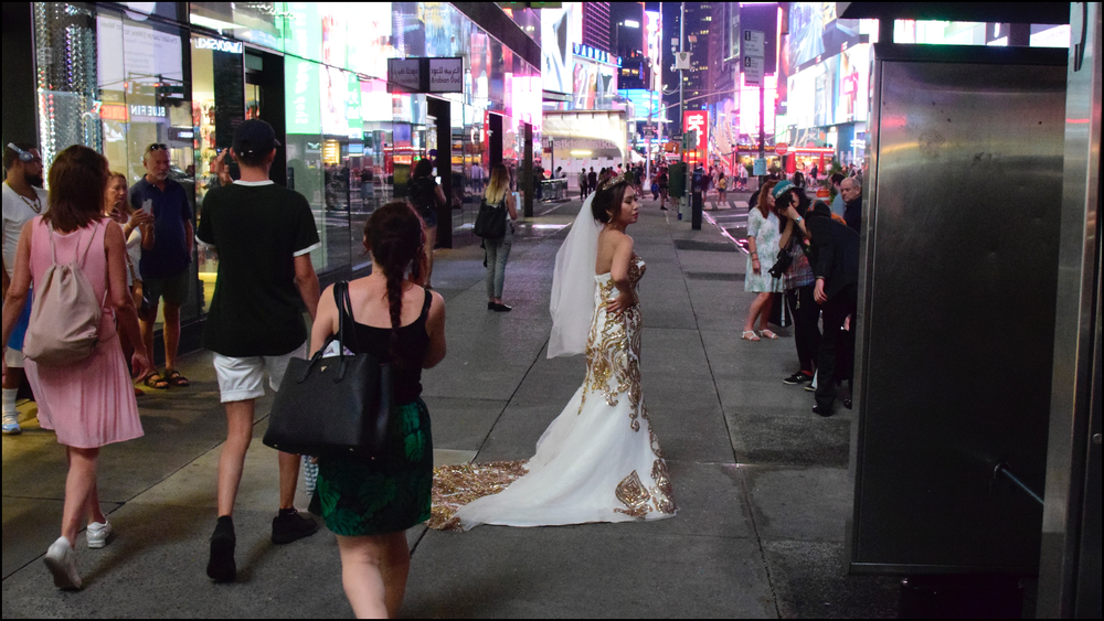 this was an interesting candid of an asian bride in times square.  (c) mark somple 2018