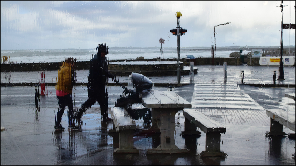 family walking a baby in the rain (c) mark somple 2018