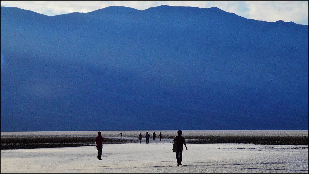 an image of people wandering out in the badwater basin in death valley (c) mark somple 2018
