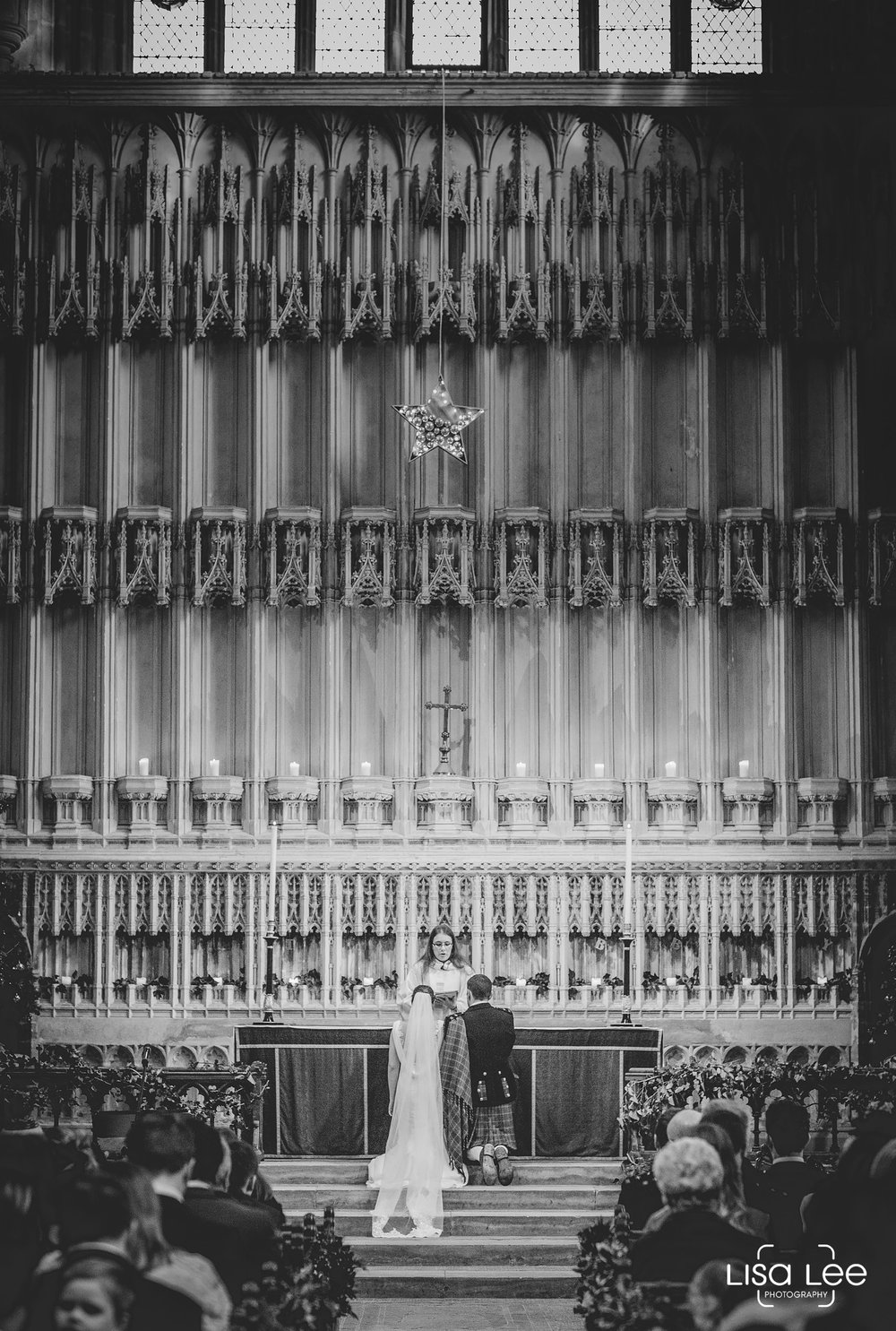 wedding-photography-milton-abbey-ceremony-kneeling.jpg