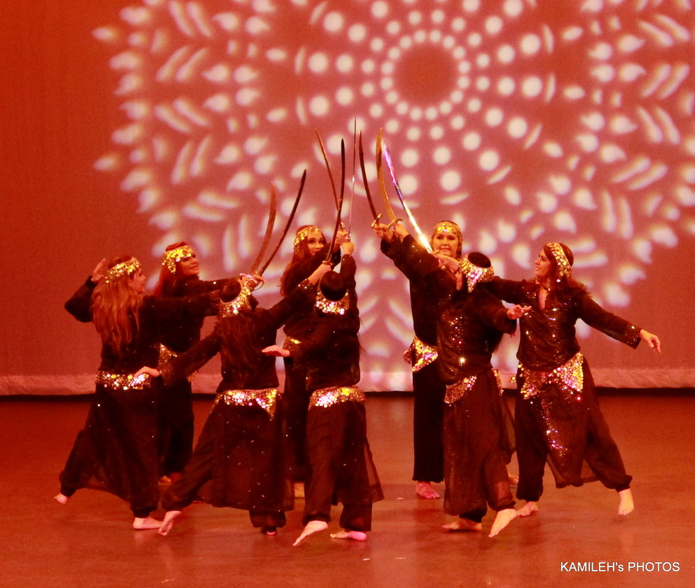 Advanced students perform a sword number at Arabian Dreams