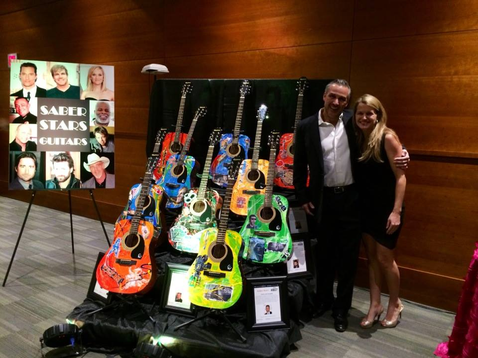 Carlos and his wife, Ellen, celebrate the auctioning of the entire guitar collection.