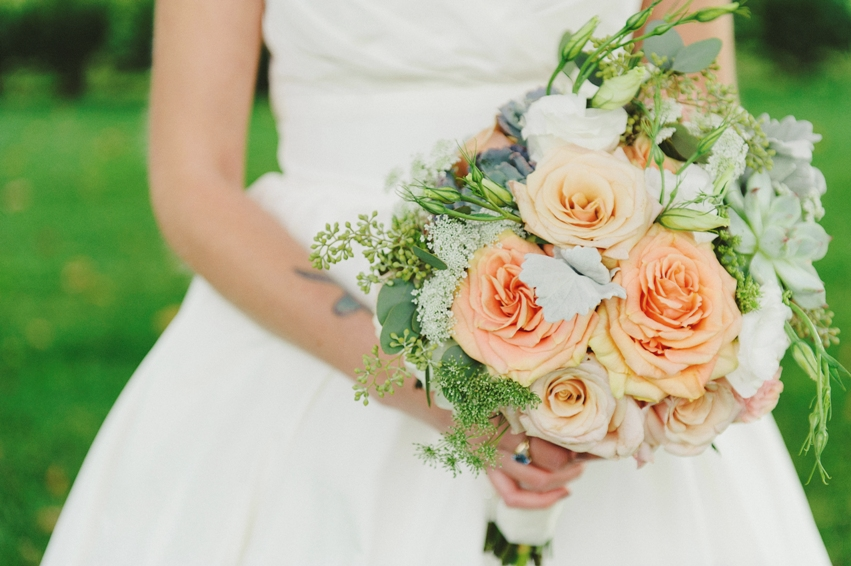 Michelle's bouquet was the perfect pairing for a Fall wedding with White hydrangea, Peach Finess Roses, Mother of Pearl Roses, Succulents, Seeded Eucalyptus, Lisianthus, and a hint of Dusty Miller and Queen Anne's Lace.