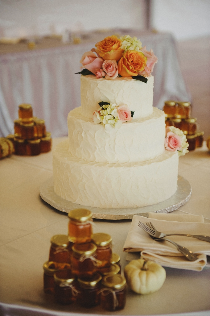 This simply beautiful cake by  Patricia's Cakes  took center stage and was highlighted with White Hydrangea, Mother of Pearl Roses, Starblush Spray Roses, and Peach Finess Roses.