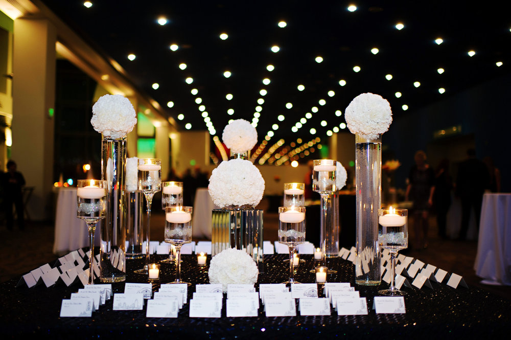 Courtenay Lambert Florals and Event Design, http:courtenaylambert.com.  Wedding of Sarah Haas & David Habel at Duke Energy Center in Cincinnati Ohio.  Gorgeous photography by Kortnee Kate, and flowers and event design by Courtenay Lambert Floral and Event Design. White Hydrangea. Christmas Wedding. Wedding florist and designer Cincinnati