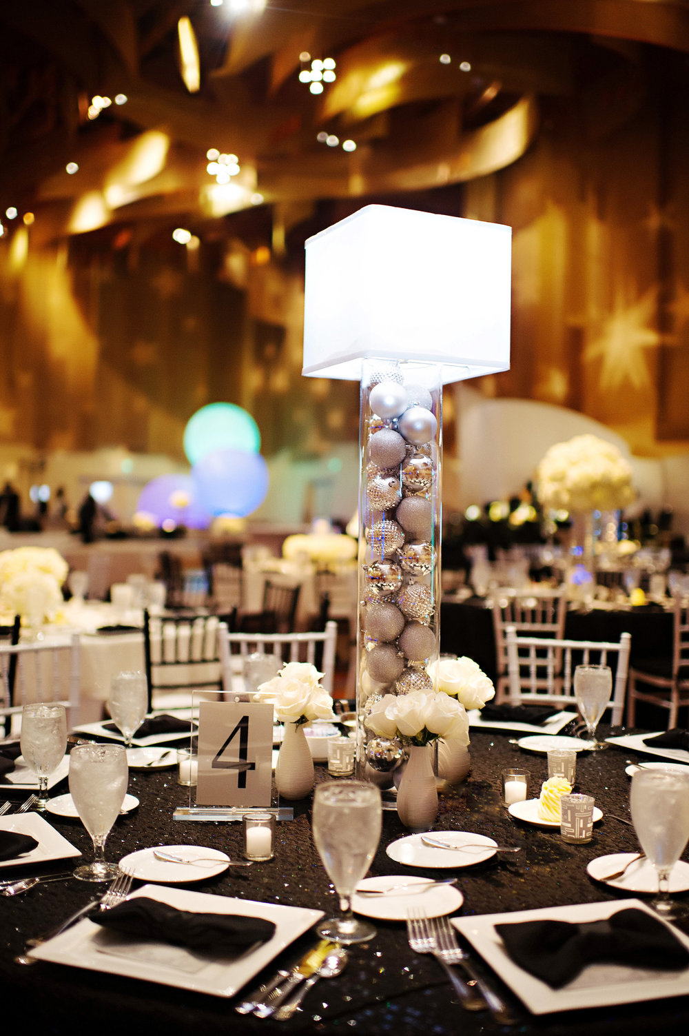 Courtenay Lambert Florals and Event Design, http:courtenaylambert.com.  Wedding of Sarah Haas & David Habel at Duke Energy Center in Cincinnati Ohio.  Gorgeous photography by Kortnee Kate, and flowers and event design by Courtenay Lambert Floral and Event Design. Ornament. Glitter. Sparkle. Christmas Wedding. Wedding florist and designer Cincinnati