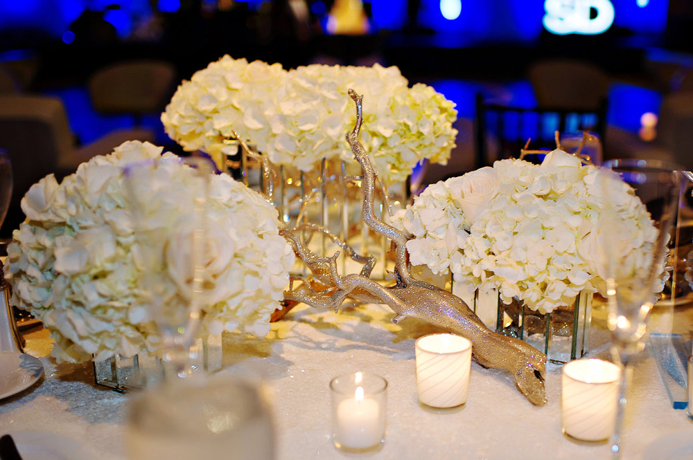 Courtenay Lambert Florals and Event Design, http:courtenaylambert.com.  Wedding of Sarah Haas & David Habel at Duke Energy Center in Cincinnati Ohio.  Gorgeous photography by Kortnee Kate, and flowers and event design by Courtenay Lambert Floral and Event Design. White Hydrangea. Glitter Sparkle Birch. Christmas Wedding. Wedding florist and designer Cincinnati