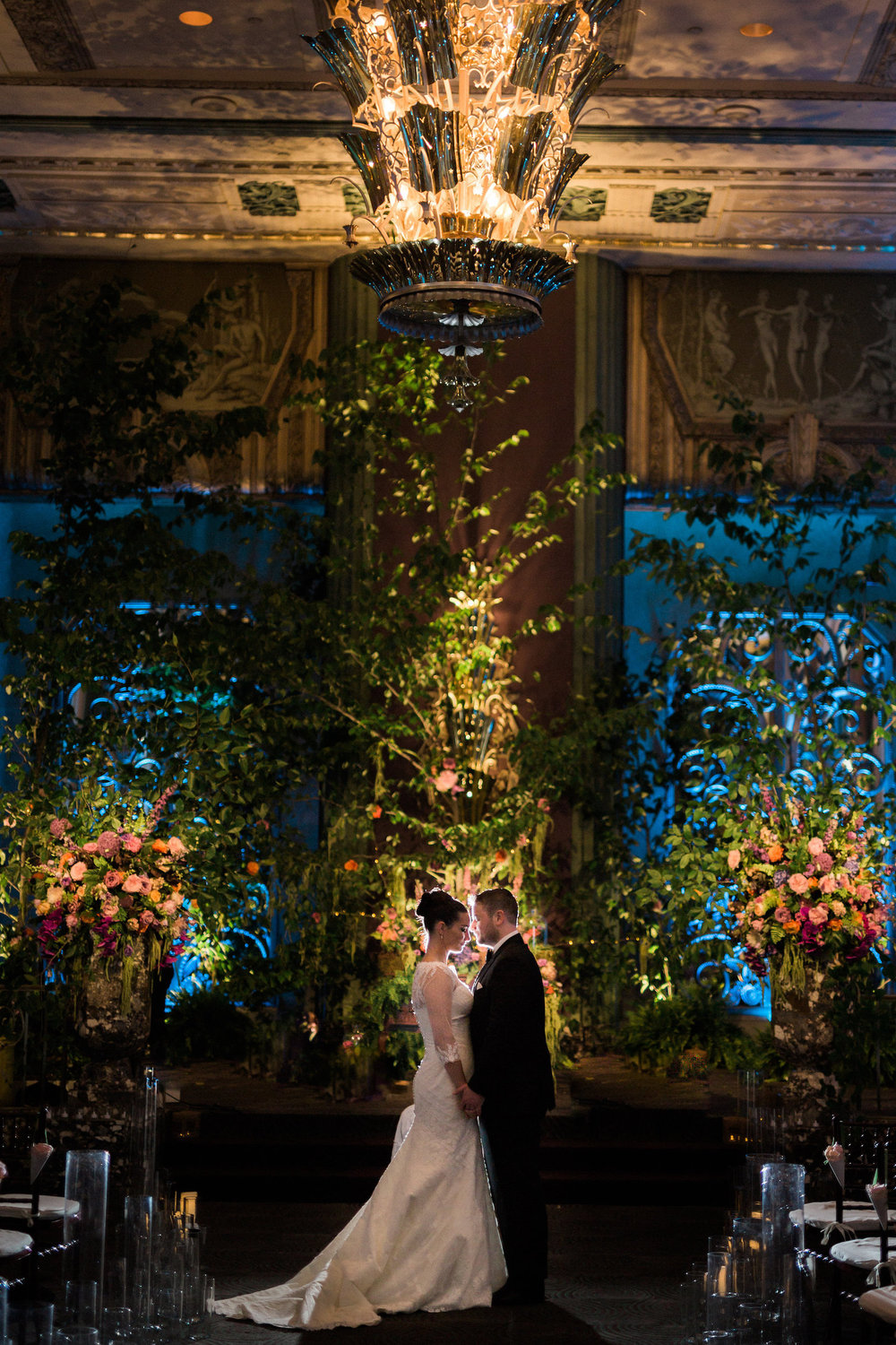 Midsummer Night's Dream Enchanted Forest inspired wedding with garden details at the  Hilton Netherland Plaza  in Cincinnati, OH. Beautiful images by    S  tyle and Story  Creative. Floral & Event Design by Cincinnati wedding florist  Courtenay Lambert Florals .Tree backdrop for ceremony with gorgeous floral designs on each side. Designs include  Rentals from  Primetime Party Rental  and  All Occasions Event Rental , Event Design and Floral Designs by  Courtney Lambert Florals , linens by  Wildflower Linen , lighting by Goodwin Lighting, and draping and bistro lights by  Fitz the Occasion .