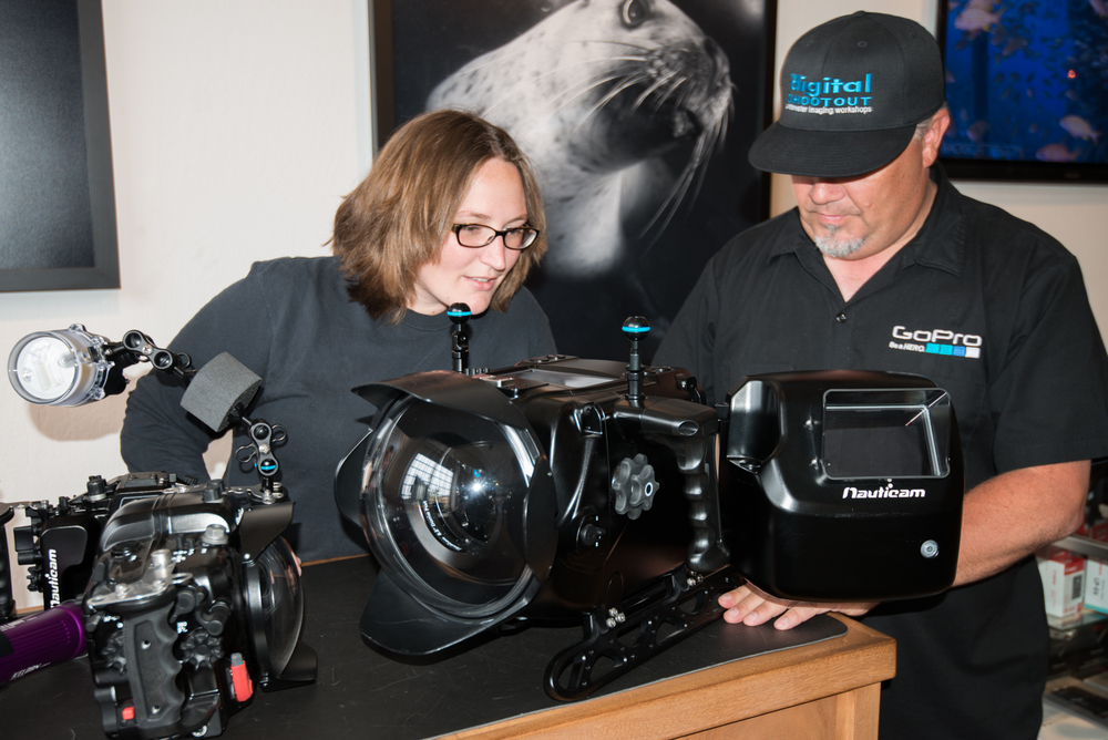 Becca Boring & Rob Duncan check out the Nauticam Red EPIC housing during a presentation from Cristian Dimitrius.