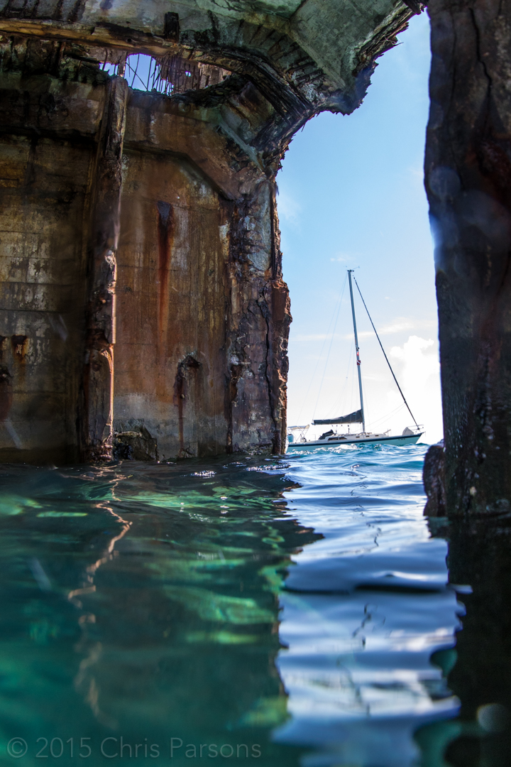 "Sailboat, though the walls of the wreck of the ""Sapona"", in Bimini, Bahamas."