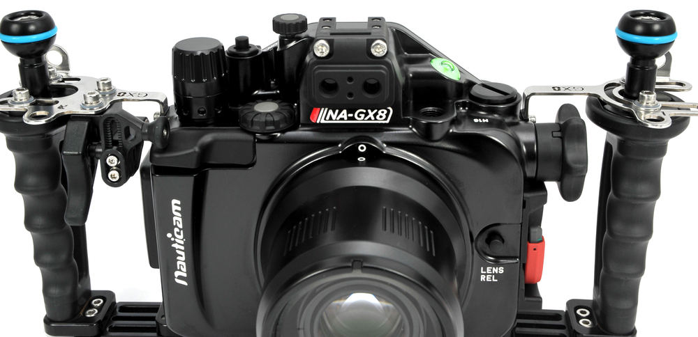 The NA-G8X, fitted with vacuum valve; the green light indicates a consistent vacuum and is an extra assurance that the system is watertight. Show with optional Flexitray, demonstrating the brackets and off board shutter release.