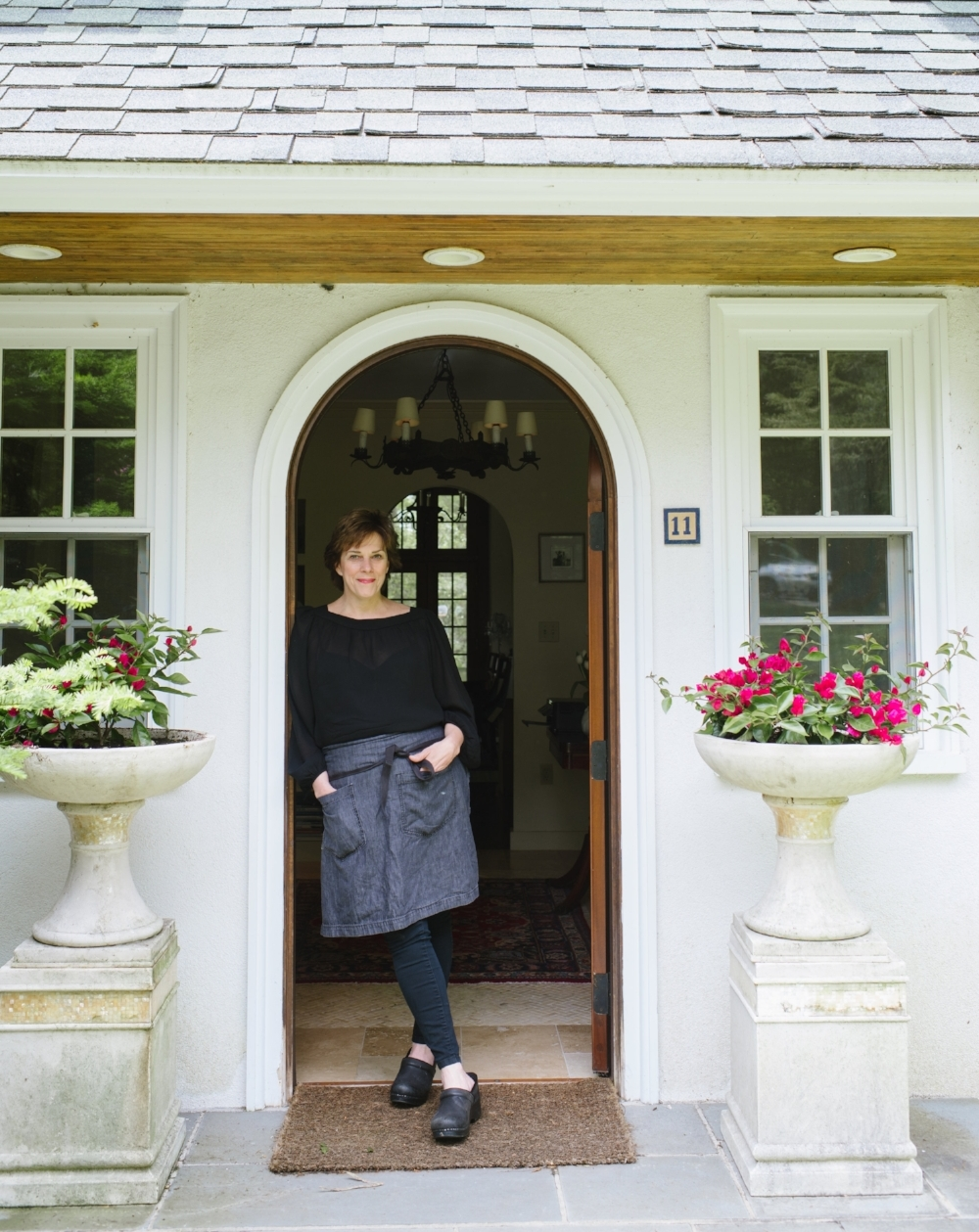 Lynch in the doorway of her Annisquam home. (Photograph by Katie Noble)