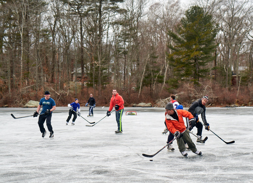 Currently on the ice (from left): Arnold Edwards, [name withheld], John Legere, [name withheld], Phil Muller (orange jacket), Archie Kasnet (behind Phil in hockey jersey), Amy Ballin (blue hat visible), and Tim Greiner. (Photograph by Michael Prince)