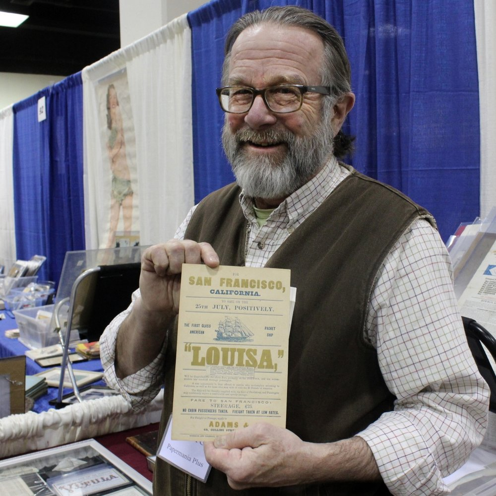Gibson displays a clipper ship card from his collection at Papermania Plus, the Northeast's largest vintage advertising and ephemera show in Hartford, Conn. (Photograph by W.A. Demers)