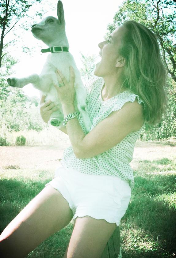Amy with one of her Nigerian Dwarf goats.