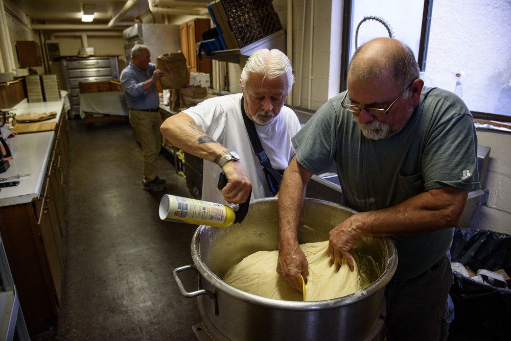 Bob Cloutman and Manny Nunes working the dough. (Photograph by Shawn Henry)