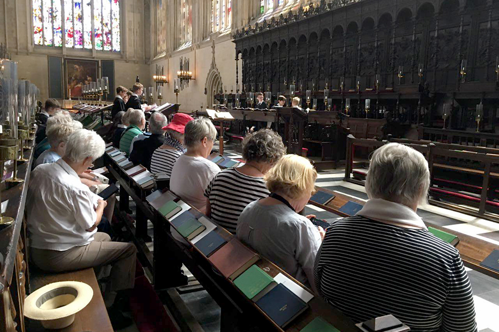 The Hayllar Music Tours group preparing for the Choir's rehearsal in King's College Chapel.
