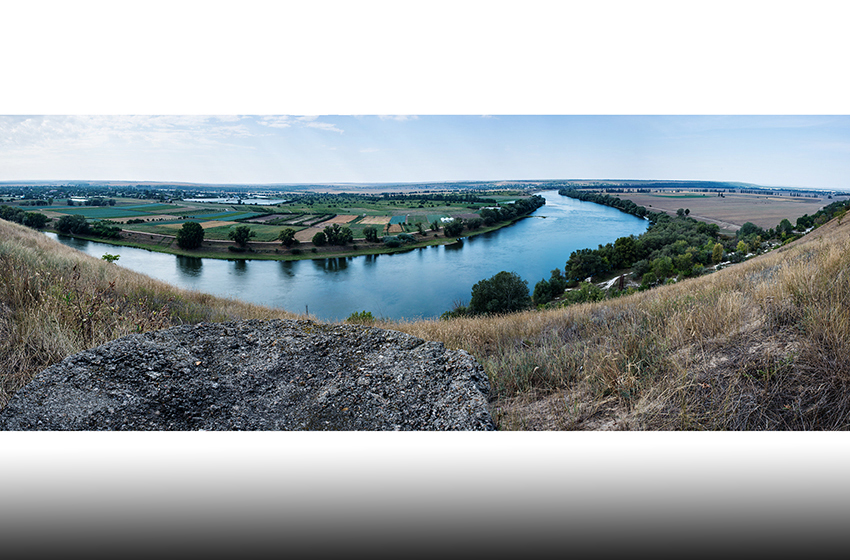 The View from an abandoned sniper pil box from the 1990-92 war. The Dniester river that gives Transnistria it's name divides the two nations, on the far side of the river lies Moldova.