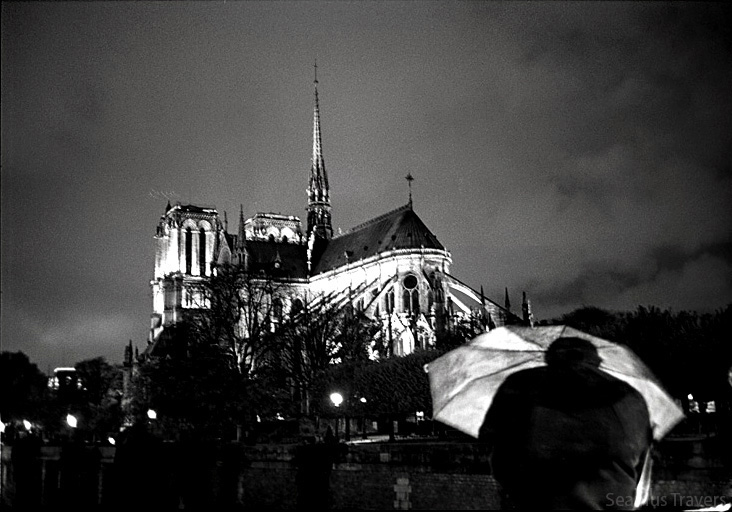 Walking into the Latin Quater passing Notre Dame, this man with his umbrella stood under a spot light.