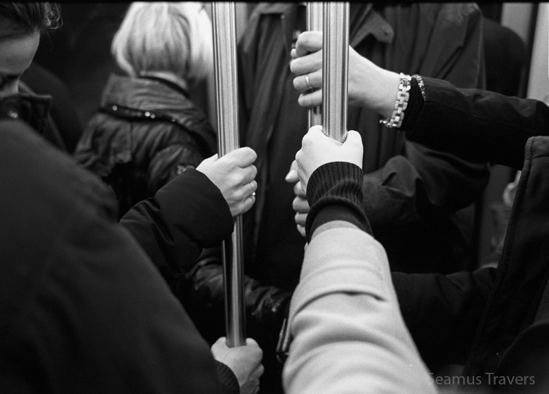 Riding the over-crowded Metro.