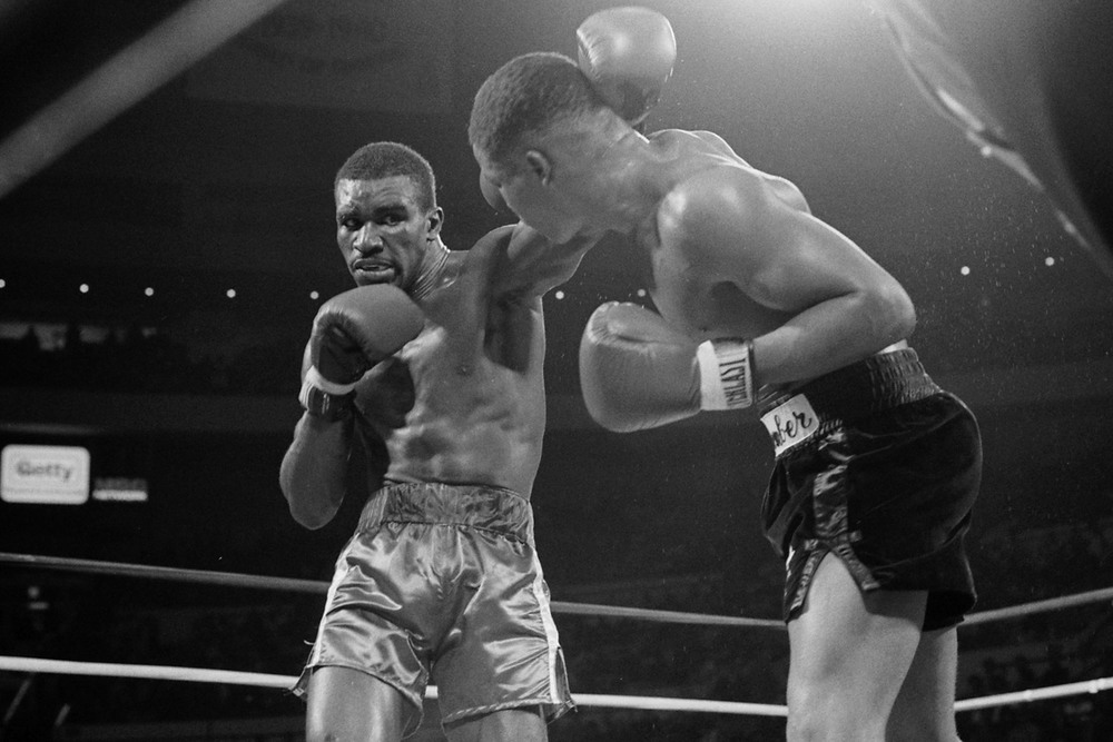 Evander Holyfield lands a left jab against Lionel Byarm in his professional debut at Madison Square Garden on November 15, 1984  (Photo by: The Ring Magazine/Getty Images)