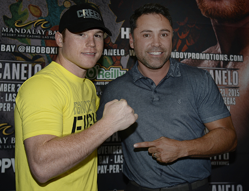 Canelo and Oscar De La Hoya pose for a photo during training camp Photo: Hogan Photos