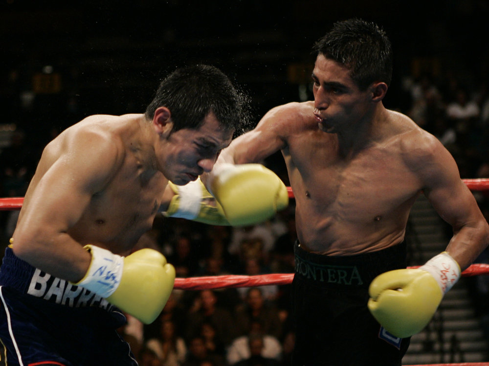 Marco Antonio Barrera, left, captured a controversial UD in his second duel with Erik Morales, right.  Photo: Will Hart