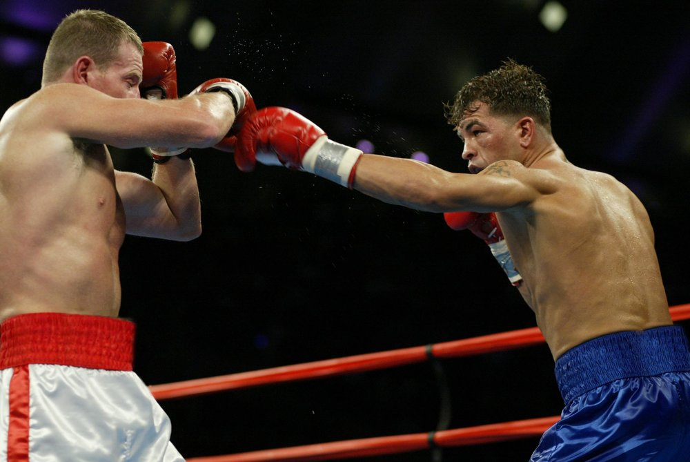 Micky Ward, left, and Arturo Gatti, right, slug it out in their second meeting. Photo: Will Hart