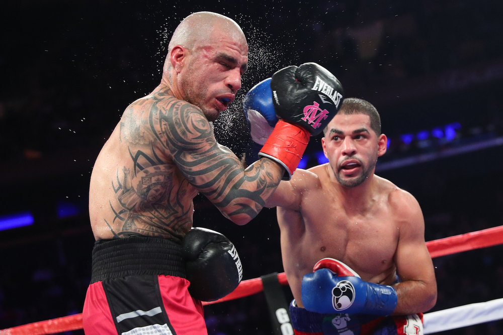 Sadam Ali connects a direct hit with Miguel Cotto in the legend's final fight. Madison Square Garden, New York. December 2, 2017.