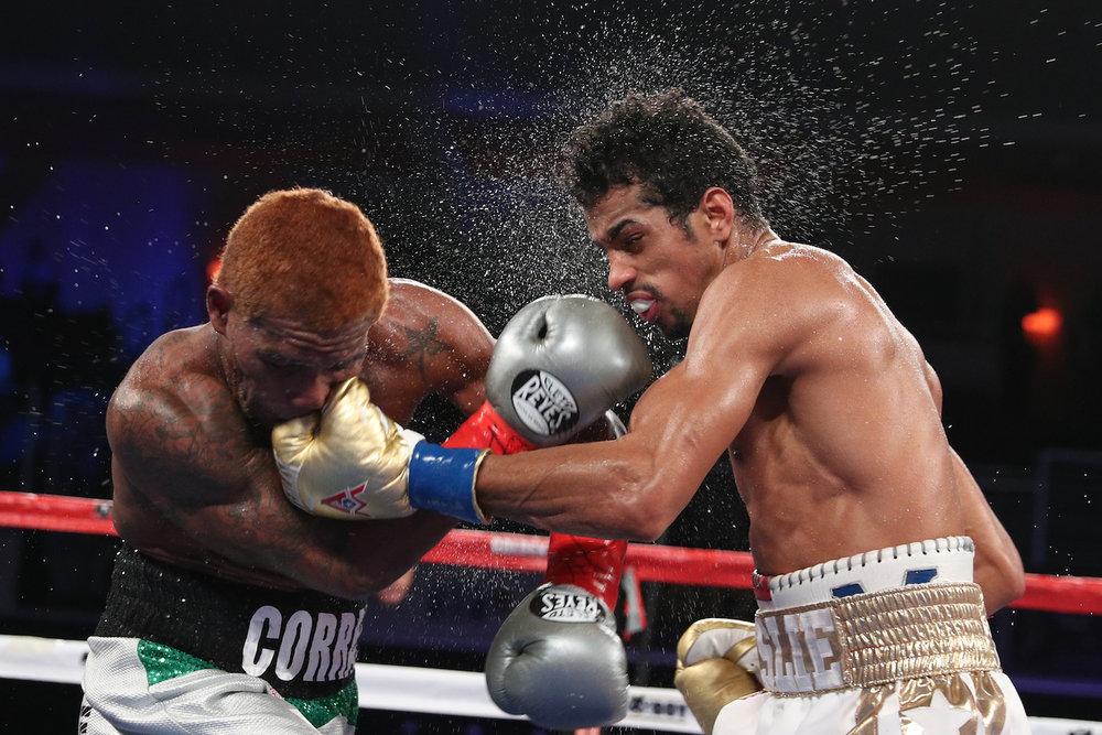 Alberto Machado and Jezreel Corrales trade punches. Turning Stone Resort & Casino, Verona, New York. October 21, 2017.