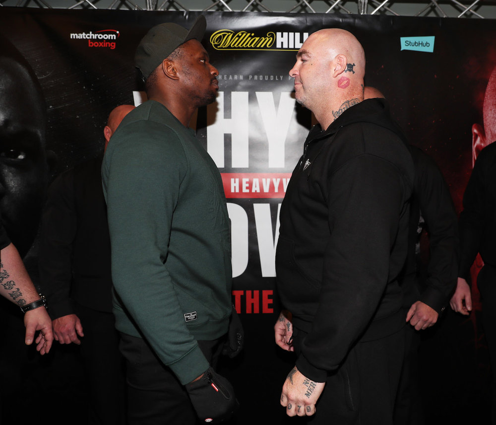 CONFERENCE-WHYTE-BROWN3 staredown.jpg