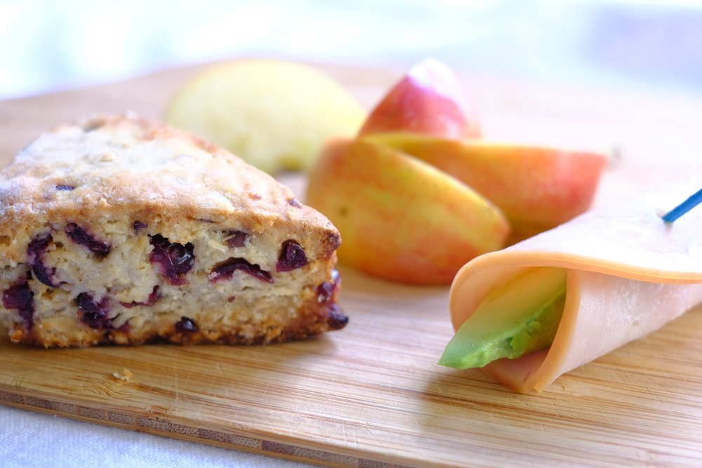 A Cranberry Orange Scone with apples and a ham and avocado roll. Add peanut butter to dip the apples and boost the protein.