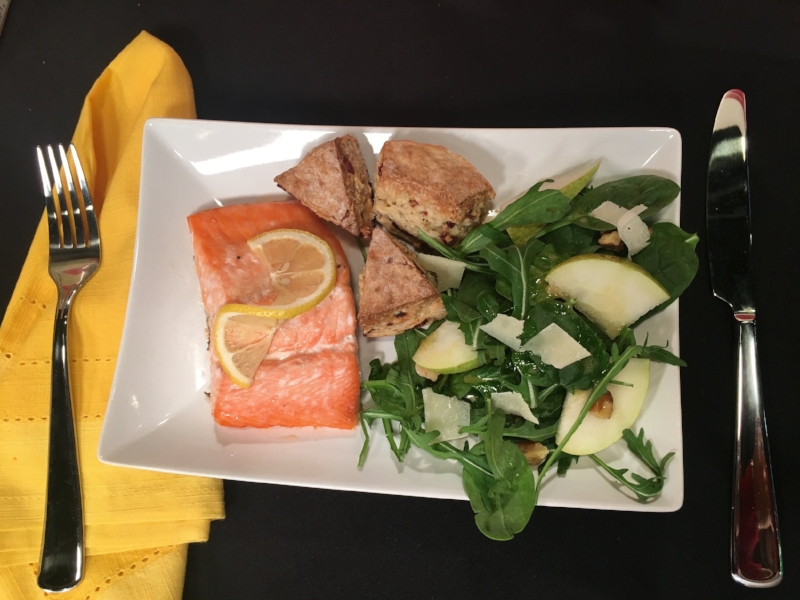 Salmon, pear and walnut spinach salad and halved cranberry orange scones.