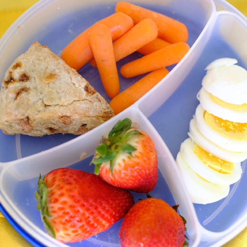 Strawberries, carrots, a hard boiled egg and sweet strawberries pair with a Cinnamon Chip scone.