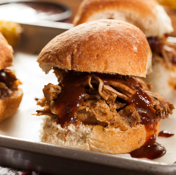 Pork sliders are great for feeding a crowd and can be cooked ahead of time and kept warm in a crock pot.