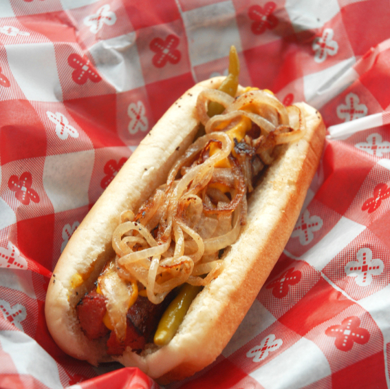 Take your hot dogs to the next level with hot sauce and sauteed onions.