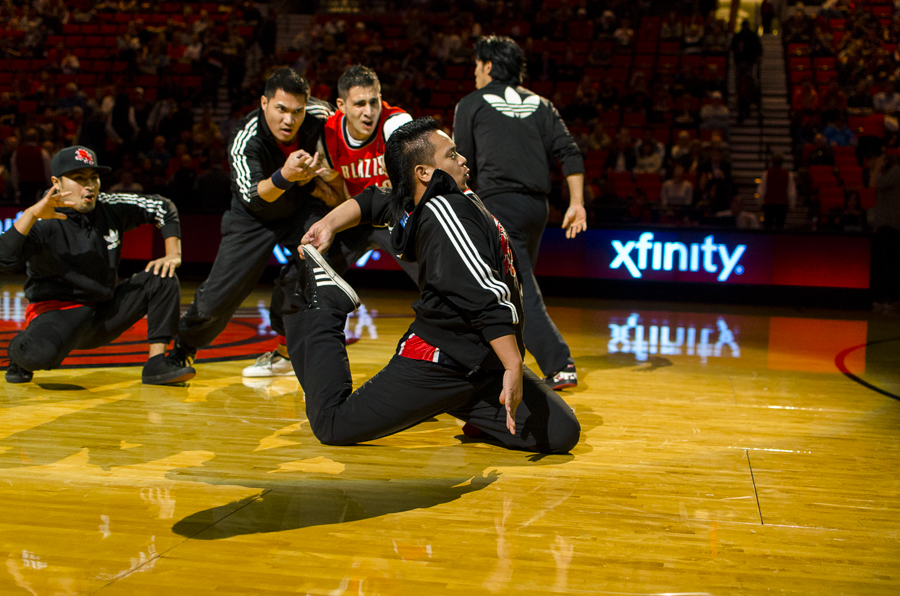 Florentino Francisco performs with Massive Monkees at halftime of a Portland Trailblazers game.