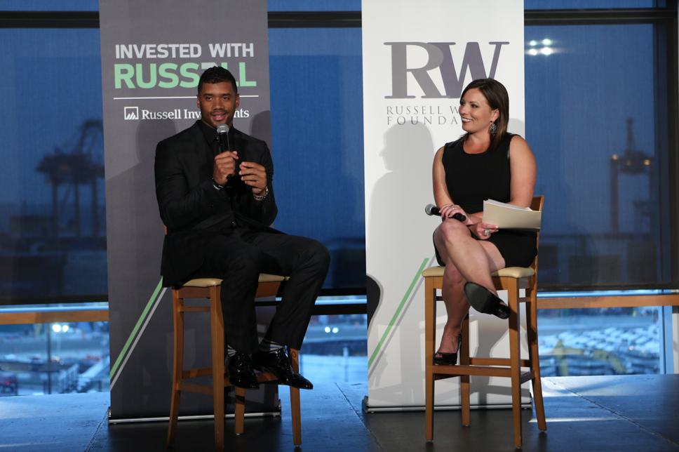 Russell Wilson talks about the vision for the  Why Not You Foundation  with event host, Jen Mueller. (Photo via  Russell Investments )