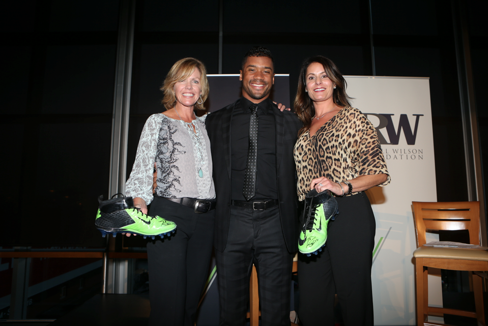 Russell with winners of his game-used autographed cleats auction.   The pair raised $6,000, with all proceeds benefiting the  Why Not You Foundation.