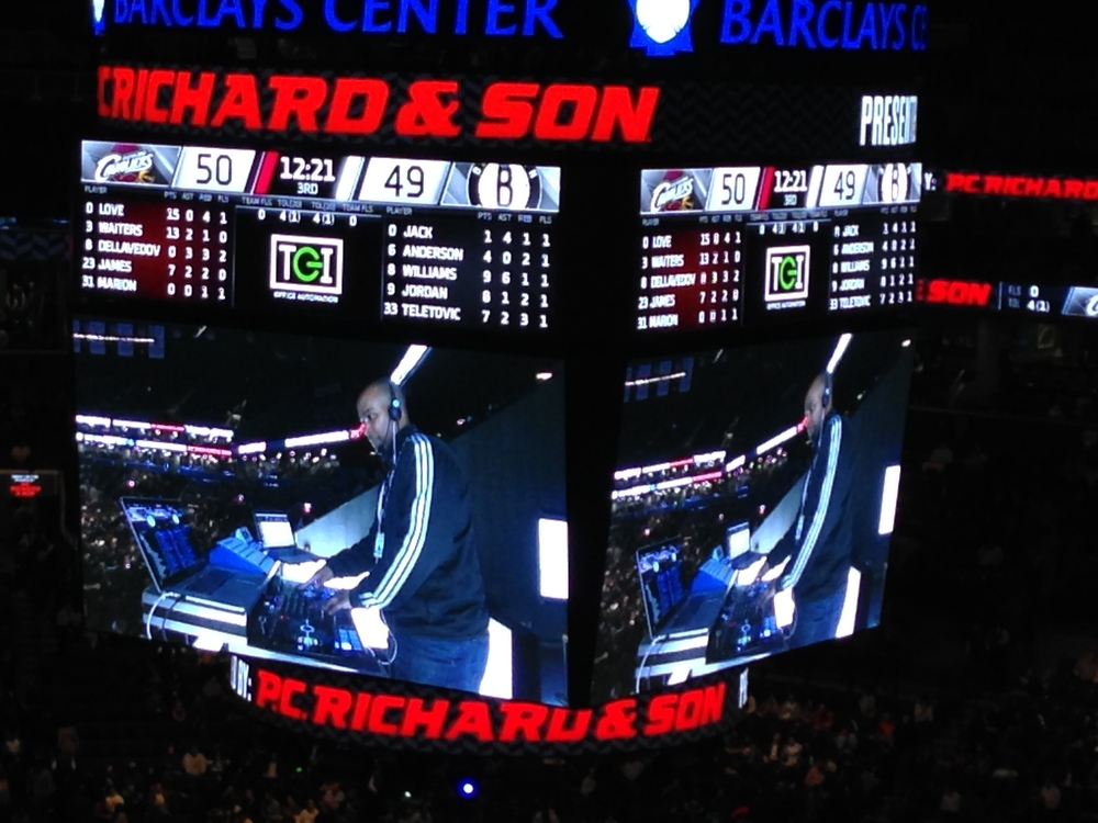 DJ M.I.L. DJ'ing at the Barclays Center during a Brooklyn Nets game.