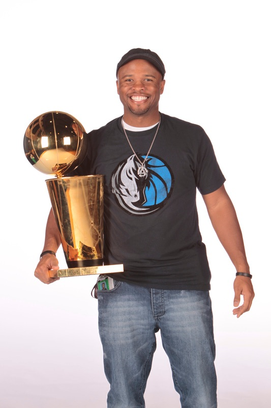 Ro poses with the Dallas Mavericks 2011 NBA Championship Trophy.
