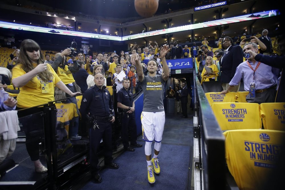 Winning an NBA Championship and earning MVP honors has propelled Stephen Curry's pregame ritual into a must-see part of the fan experience at Golden State Warriors games, drawing an early-arriving and engaged audience. (photo via wsj.com)