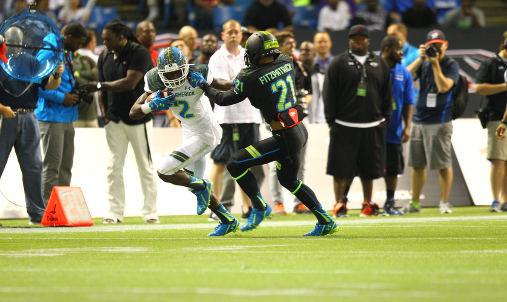 Calvin Ridley stiff-arms another current NFL star, Minkah Fitzpatrick, during the 2015 Under Armour All-America Game.