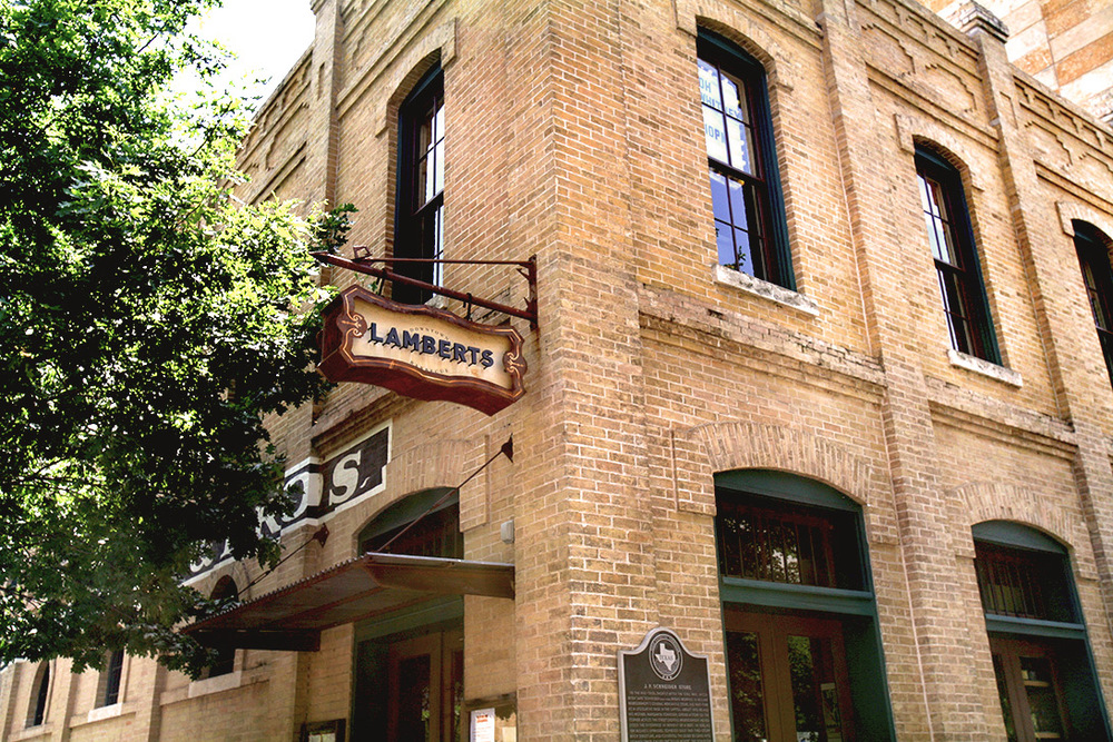 Lambert's is housed in the historical J.P. Schneider & Sons Building in downtown Austin, TX