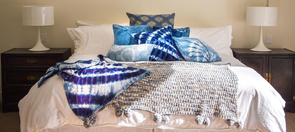 pillows & blankets by hue - click to shop