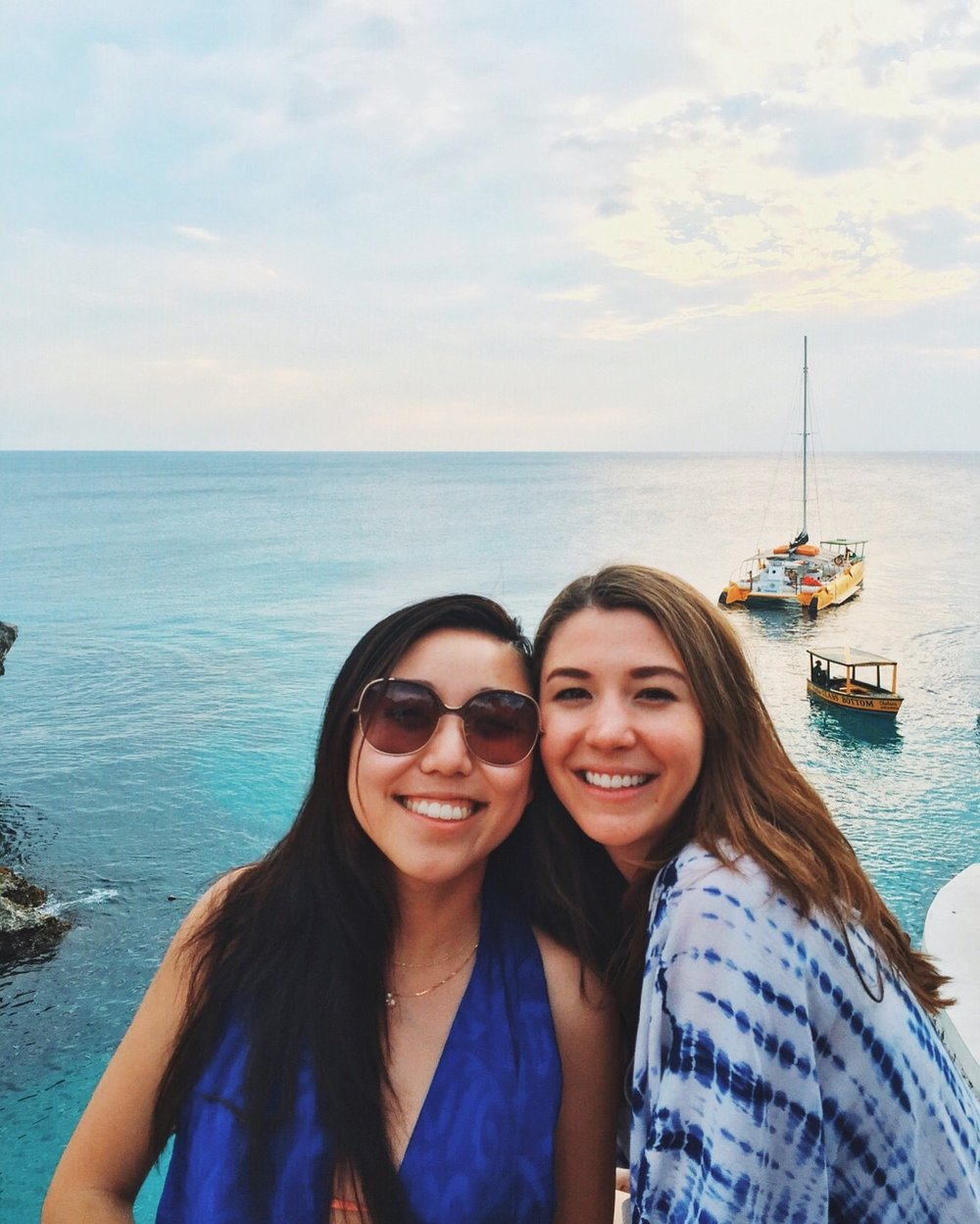 A picture of two girls that were too chicken to jump off the cliff at Ricks Cafe
